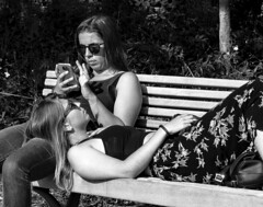 Lazing in the sun. (All I want for Christmas is a Leica) Tags: people monochrome blackwhite street girls arrest lazingabout panasoniclumix panasonic lumix m43 microfourthirds mirrorless