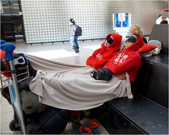 Rest a While (Hindrik S) Tags: rest while schiphol two girls red sweather sleeping beauty candid blanket tired wurch moe slaperig slapen sliepe sleep schlafen lugage bagage traveling reizgje reisen reizen sonyphotographing sony sonyalpha a57 α57 slta57 tamron tamronspaf1750mmf28xrdiiildasphericalif amount