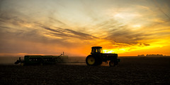 Switching gears today.... (nwitthuhn) Tags: jd drills wheat planting kansas sunset