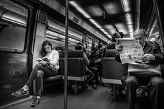 Readers on the wheels (Mustafa Selcuk) Tags: paris parisienne metro subway reader readers blackandwhite bnw bw nb neb noiretblanc monochrome monochromatic street streetphotography streetphotos streetphotographer fujifilm fujifilmtr fujifilmfrance fujifilmfr kitaplaryolda books