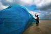 untitled (soumik_itmam) Tags: people life lifestyle river fishing net man sky hard blue bangladesh