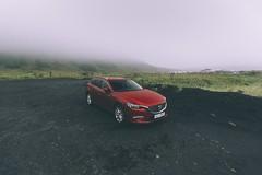 (Jordan Kines) Tags: automotive fog mazda car red blacksandbeach blacksand icelandic iceland vik