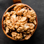 Walnuts in a ceramic cup , top view thumbnail