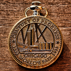 Souvenir Of The Century (Alfred Grupstra) Tags: macromondays souvenir business symbol metal goldcolored woodmaterial clock currency singleobject backgrounds closeup oldfashioned coin finance watch chicago