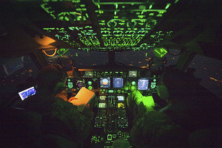 Addison Schenk, copilot, monitor the controls of a C-17 transporting Marine Corps Gen. Joe Dunford, chairman of the Joint Chiefs of Staff, from Iraq's Kurdistan region, April 22, 2016.