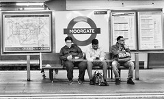 Where Did I Leave My Phone ? (tcees) Tags: moorgate ec2 moorgatestation londonunderground londontransport people urban bw blackandwhite mono monochrome street streetphotography x100 fujifilm tube sign bench seat platform map