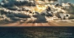 Sunrise in Cancun (garofano_richard) Tags: sunrise cancun mexico clouds sunshine sunrays