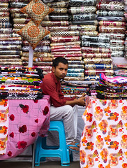 Blanket seller (ysoseriuos) Tags: streetphotography hyderabad india indiastreetimages indianmarket seller candid candidphotography eyecontact amatuer streetimages streetvendors canon 85mm18