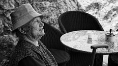 I Really Don't Mind If You Sit This One Out (Alfred Grupstra) Tags: blackandwhite people senioradult oneperson old sitting outdoors women retirement oldfashioned females agingprocess seniorwomen hat chair cultures portrait retrostyled 983