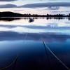 Tethered (burnsmeisterj) Tags: olympus omd em1 sunrise scotland trossachs lochrusky boats loch reflection