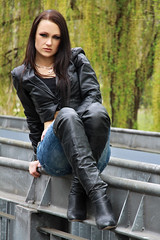 Alexandra 60 (The Booted Cat) Tags: sexy brunette model girl leather jacket thight blue jeans denim overkneeboots overknee boots heels highheels
