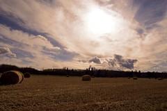 Alberta (lydiablackwell) Tags: alberta hay bales sun edited plains