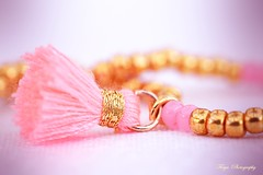 Fluffy Fashion Style... (Maria Godfrida) Tags: macro closeup macromondays souvenir mm hmm 7dwf beads bracelet fluffy golden pink clusterfringe