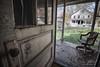 28 Main Street (Linda O'Donnell) Tags: yellowdogvillage miningtown ghosttown abandonedamerica abandonedplacesinamerica abandonedbuildings vintagehouse abandonedplacesinpa interior doorway windows chair porch