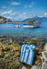 Γαλανόλευκη η θωριά σου (Dimitil) Tags: sea seascape pelion coastal coast boats clouds nature magnesia thessaly greece hellas people fisherman fishing flag rocks