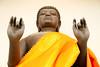 Thinking about the world (Robyn Hooz) Tags: buddha yellow thai thailandia thoughts world mondo testa ricci curls hands mani statua statue