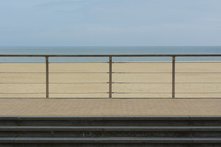 Steps, fence, sand and sea