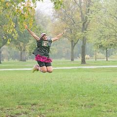Jumping for Joy in the Rain at Hurts Donuts Run in Iowa City, Iowa (Oliver Leveritt) Tags: hurtsdonut hurtsdonutrun iowacity iowa benefit charity rainy day rain highiso grainy run walk event donuts girl jump leap hurtsdonuts