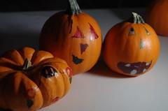 Jack-O-Sharpie? (erluko) Tags: kids pumpkins orange jackolantern marker permanent sharpie colors flash shadow darkness halloween flickrfriday orangedecoration