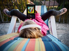 Relax II (B-Lichter) Tags: olympus pen epl7 mzuiko 1718 child childhood girl music headphones tablet stripes color deckchair lounger balcony colors