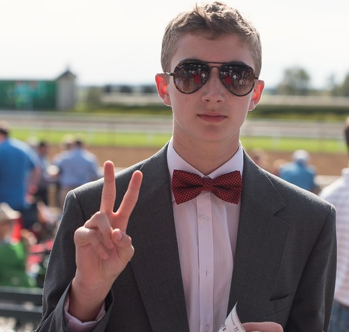Portrait of my son after he won his second exacta of the day
