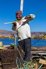 Uru Worker, Lake Titicaca, Peru (Aethelweard) Tags: puno peru uros uru laketiticaca floatingislandsofuros