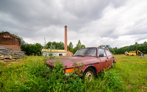 Red car in abandoned industrial site