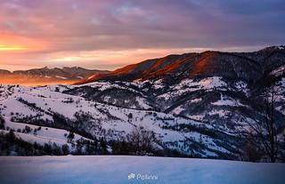 winter sunrise in mountainous rural area-171710