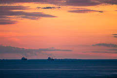 Crossing into Night (langdon10) Tags: atsea canada canon70d cargoship navigation quebec ship shoreline stlawrenceriver sunset tanker troisriviere clouds nautical outdoors
