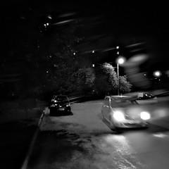 •Night After Rain {bnw} ☔️🌙🚗 (sergiochubby) Tags: inexplore onlymobileart onlymobile iphoneonly nostalgia hipsta ukraine mobileart hipstamagic phoneographic mobiography hipstamatic hipstamaticmagic hipstadreamers kharkiv visualukraine iphoneography vintage beauty elements artistic urbanexploration urbanlife genreart lofi genrephoto streetphoto street bnwdemand squaregraph squaregraphy motion noir melancholy nostalgic bnwmood urbanlook dramatic urbanscape urbanexplore streetphotography cinematic lamppost foliage photoart mobile city urban lifestyle cinema bokeh monochrome blackandwhite bnw awesomebnw dreamy night rain traffic puddle wet minimal lights nightlights streetlights road tree car building intersection
