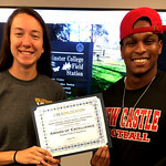 Laura Page and Terrell Cleckley holding the BEA Student Video Excellence Award certificate