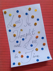 Lost in thought and lost in time. (Somersaulting Giraffe) Tags: indoor pinkfloyd comingbacktolife lyrics artclip paper art colours white blue yellow glitter red orange thought lost time seedsoflife song serenity black oldsoul 90s