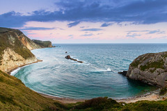 Man O'War Bay (Rich Walker75) Tags: manowar bay dorset durdledoor landscape landscapes landscapephotography landmark landmarks sea coast coastal coastline beach beaches sky seascape seascapes england uk greatbritain dusk cliff cliffs water waves canon efs1585mmisusm eos100d eos outdoor cloud clouds
