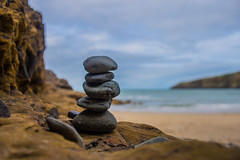 Perfect balance (GarethBell) Tags: balanced tower anglesey north wales northwales churchbay bay stones pebbles rocks balance sea sky beach sand clouds water wet outdoors outside grey blue yellow 5 five tall focus canon 6d canon6d 35 35mm hdr coast northwalescoast waves wave surf