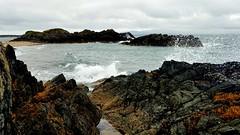 Llanddwyn Island (mandysp8) Tags: waves ocean seaspray volcanicrocks greensea