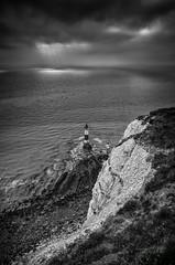 Beachy Head Lighthouse (Lloyd Austin) Tags: nikond5100 sigma1750mm coastline coastal sunrays chalk cliffs tide beach monochrome mono blackandwhite bnw bw water ocean seascape sea dramatic atmospheric dark stormy overcast sky clouds england eastsussex lighthouse beachyhead