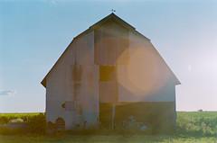 untitled-96-Edit (dvlmnkillatron) Tags: olympus om2n selfdeveloped 35mm analog film farmhouse illinois field abandoned lensflare