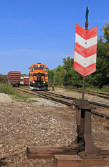 Working the lines (GLC 392) Tags: switch stand els escanaba lake superior mi michigan pine tree derail sign telephone poles emd gp38 gp382 wells gn great northern life storage line lines 400 railroad railway train grass sky locomotive forest car