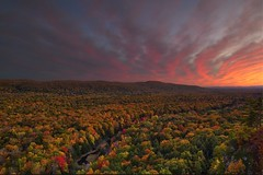 Porcupine Mountains Sunset (Alan Amati) Tags: amati alanamati america american usa us mi michigan mich up upper upperpeninsula peninsula porkies porcupinemountains porcupine mountains valley state park fall fallcolor autumn sunset dusk setting sun sky trees forest overlook escarpment trail nature natural red glow carpriver river late lateafternoon afternoon landscape firey fire afterglow october puremichigan ontanogan midwest lakeoftheclouds topf25