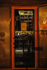 Shopaholic (bMi2fotografx) Tags: fun intrigue walking brenda paper signage glass door orange pun international bratislava travel unopened streetphotography wines closed shopaholic