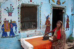 Ironing woman (Dick Verton) Tags: india asia varanasi streetview woman ironing streetviewdailylife wallpainting blue
