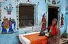 Ironing woman (Dick Verton ( more than 12.000.000 visitors )) Tags: india asia varanasi streetview woman ironing streetviewdailylife wallpainting blue