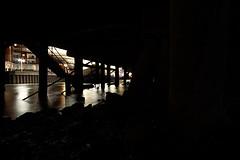 Underneath the pier (Sarah Marston) Tags: portsmouth portsmouthharbour strongislandphotographywalkshop night pier lights steps rocks shore sony alpha a77 september 2017