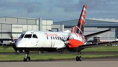 G-LGNA (AnDyMHoLdEn) Tags: loganair saab saab340b egcc airport manchester manchesterairport 23l