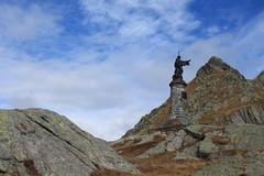 Col du Grand St-Bernard (bulbocode909) Tags: valais suisse italie statuedestbernard statues frontières coldugrandstbernard montagnes nature rochers nuages bleu automne