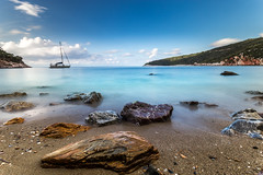 Stafilos beach sunrise (kubaszymik) Tags: long exposure expo grey filter nd1000 longexpo sand bay morning dawn sunrise greece greek island skopelos sporades thessaly aegan sea sky clouds blur motion waves boat vsco canon grecja forest trees sailing blue water aqua