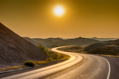 Sunrise over the Badlands (Pejasar) Tags: sun gold nature beauty golden glow light road landscape sunrise badlandsnationalpark southdakota