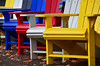 Autumn seat sale (James_D_Images) Tags: adirondack chairs yellow white black blue red sidewalk autumn fall fallen leaves pattern repetition