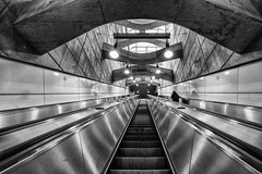 Uo to the Top (laga2001) Tags: underground subway light contrast metro escalator stairways stairs concrete shadow black white bw bnw monochrome architecture vienna europe traveller austria schottentor up top upstairs tunnel transport geometry symmetrical geometric structure pattern