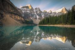 Moraine Lake (Margarita Genkova) Tags: banffnationalpark canada morainelake rockymountains alberta reflections mountains water lake rocks colors peaks sky morning